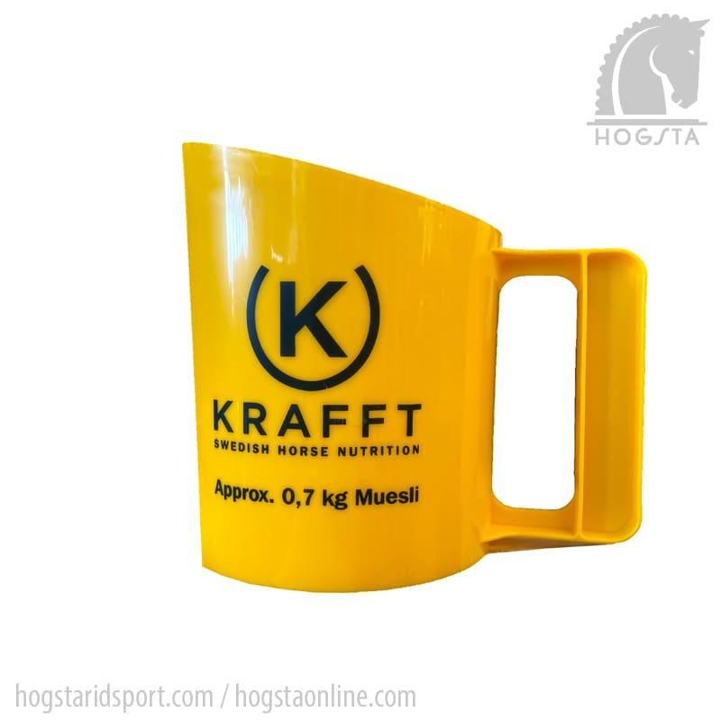 Gul foderskopa för ca 0,7 kg müsli från Krafft Hogsta Ridsport.